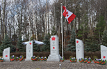 All five stones from the Petawawa Cenotaph with Canada Flag in view