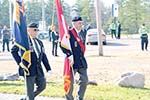 Two members of the Colour Party walking with flags