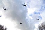 Four Chinook Helicopters flying in formation