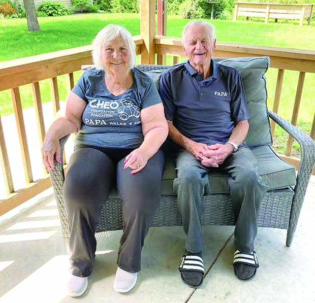 Russell and his wife Doreen sitting on porch
